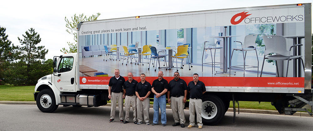 Instillation services hero image - truck with employees