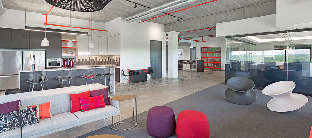 JLL Project Highlight: wide shot of kitchen and lounge area