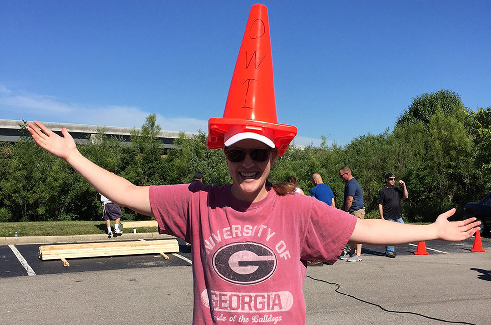 OW employee plays around during Habitat for Humanity Build with cone on his head