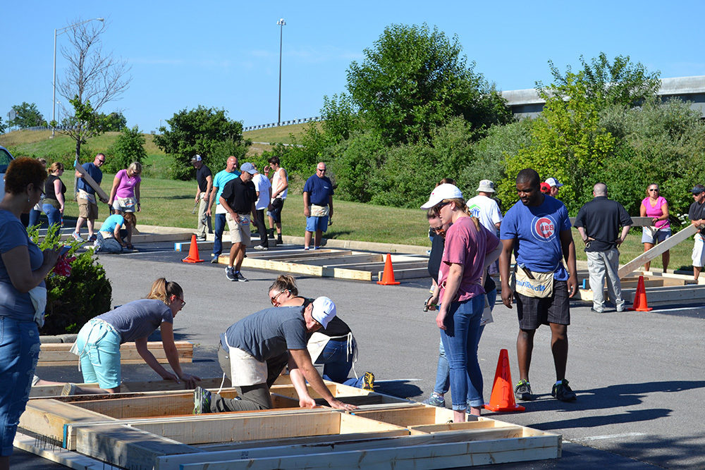 Far view of OW employees working during Habitat for Humanity Build