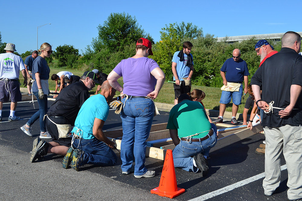 OW employees gather around project during Habitat for Humanity Build