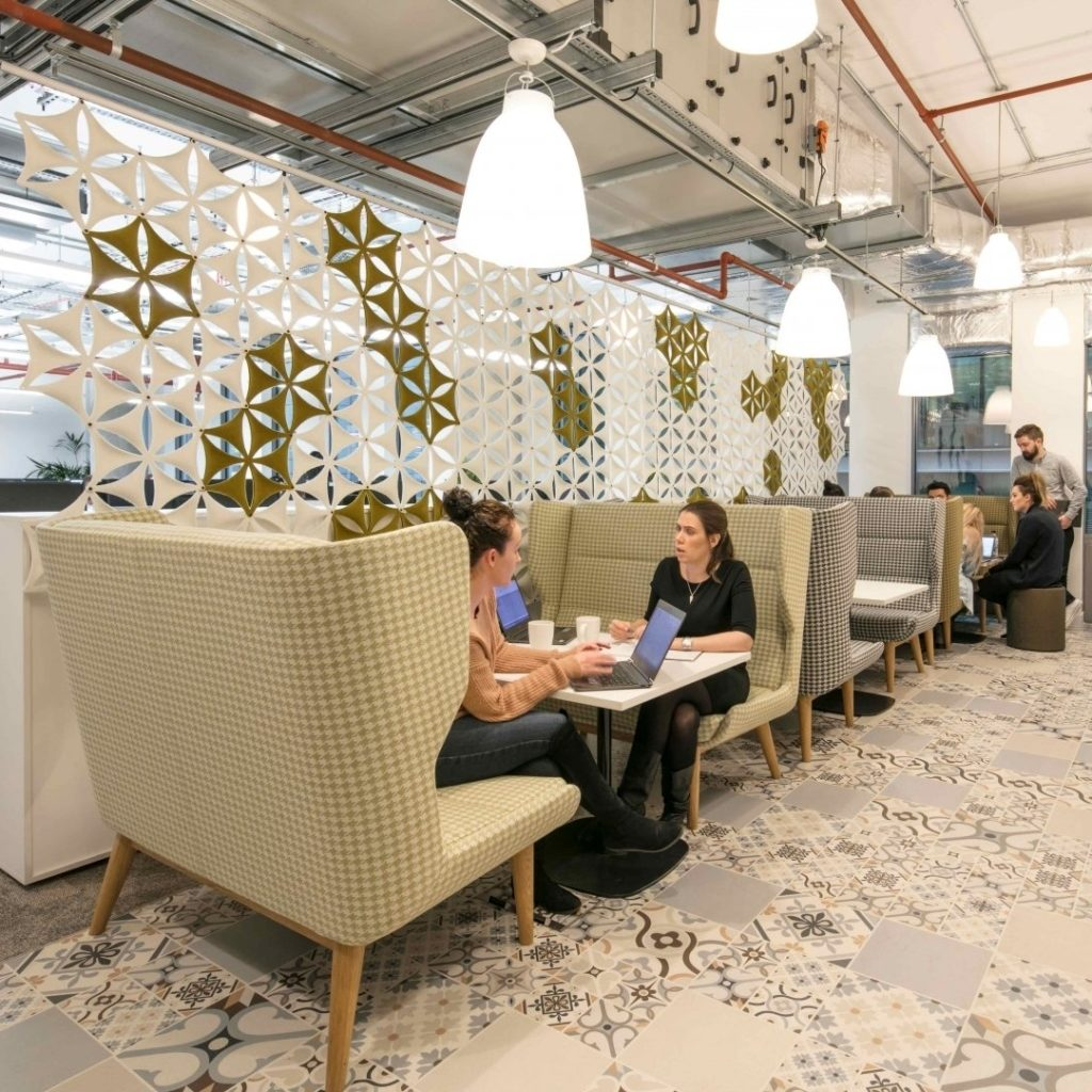 Naughtone Hush sofas and work tables shown with people working on them