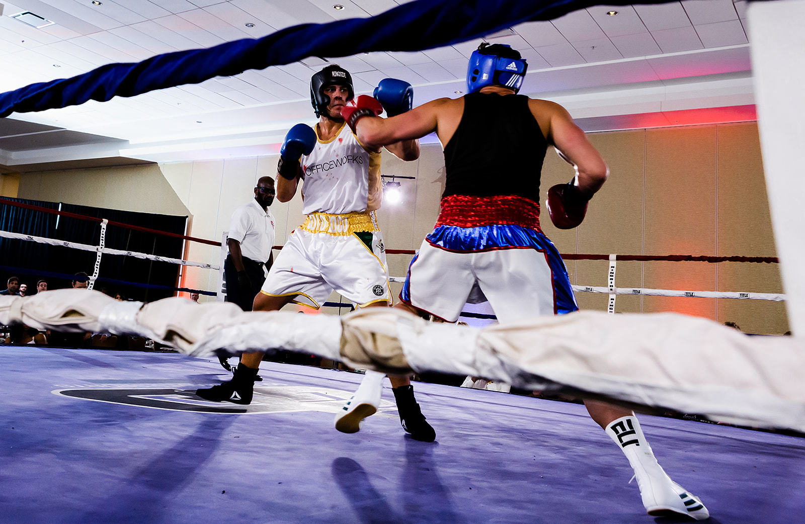 Scott O'Neil throws punch to opponent during charity boxing match