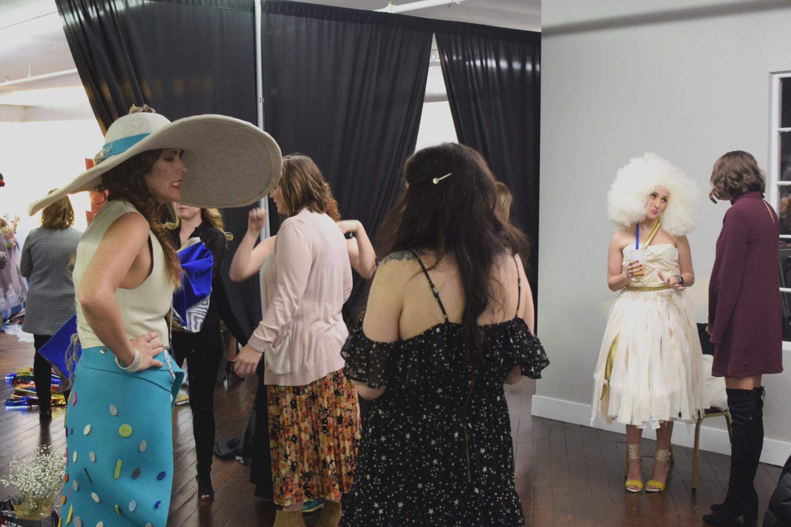 Guests and models talk after the IIDA Fashion Show