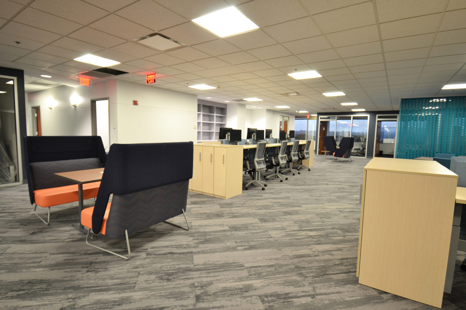 Prof. Services Firm Project Highlight: back view of booth tables and desk space