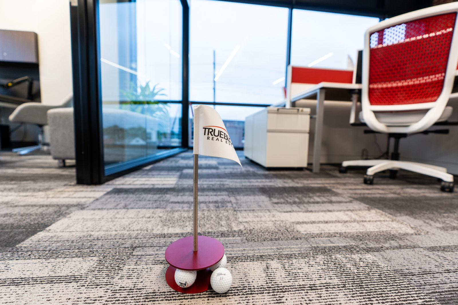 Trueblood Real Estate golf putting game in new office provided by OfficeWorks