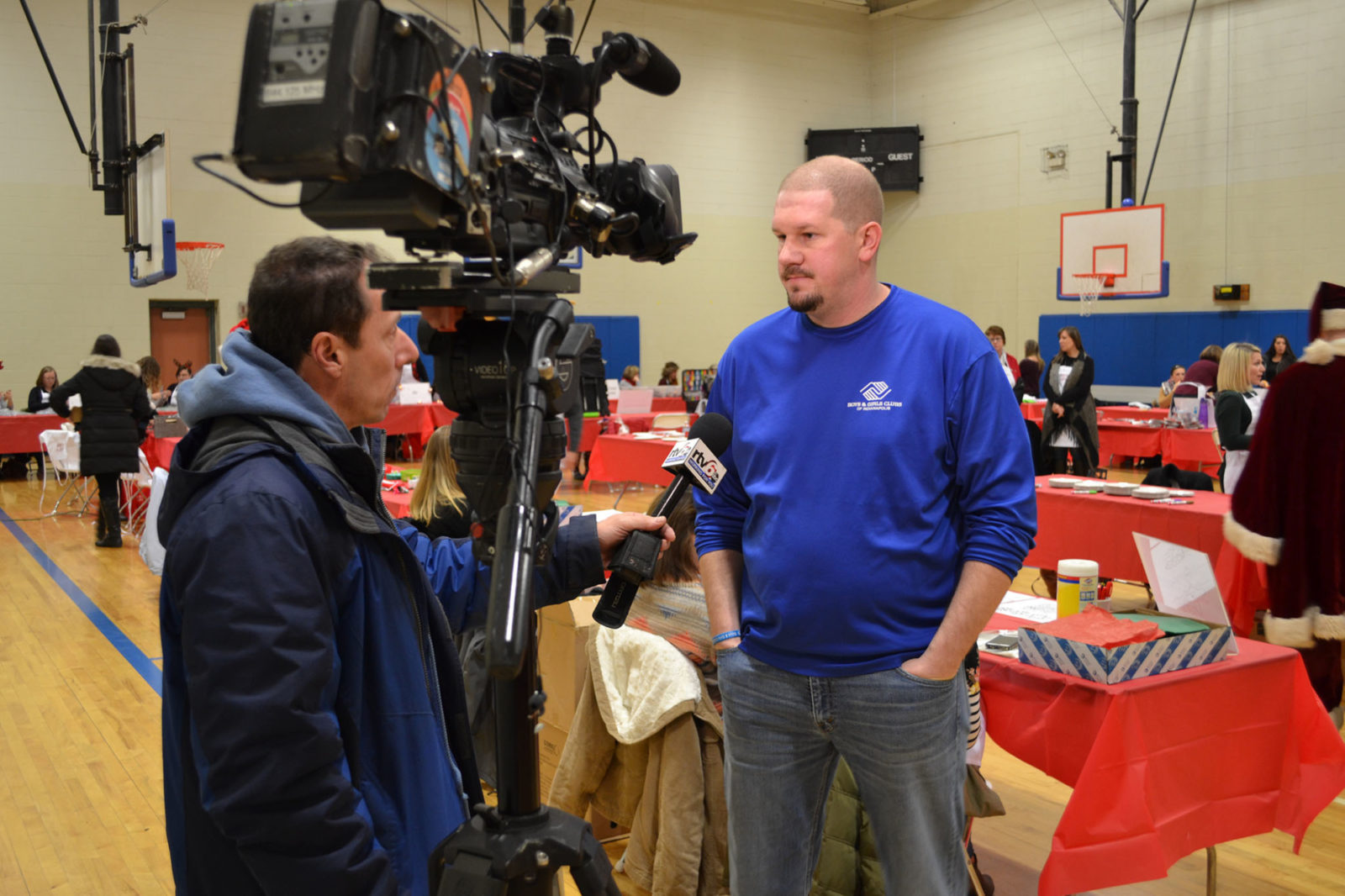 WeCare event 2018: Boys and Girls Club representative being interviewed by TV cameras