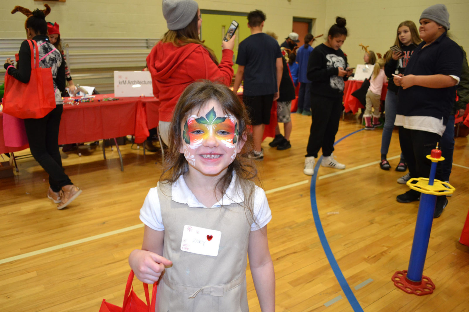 WeCare event 2018: girl shows off her face paint