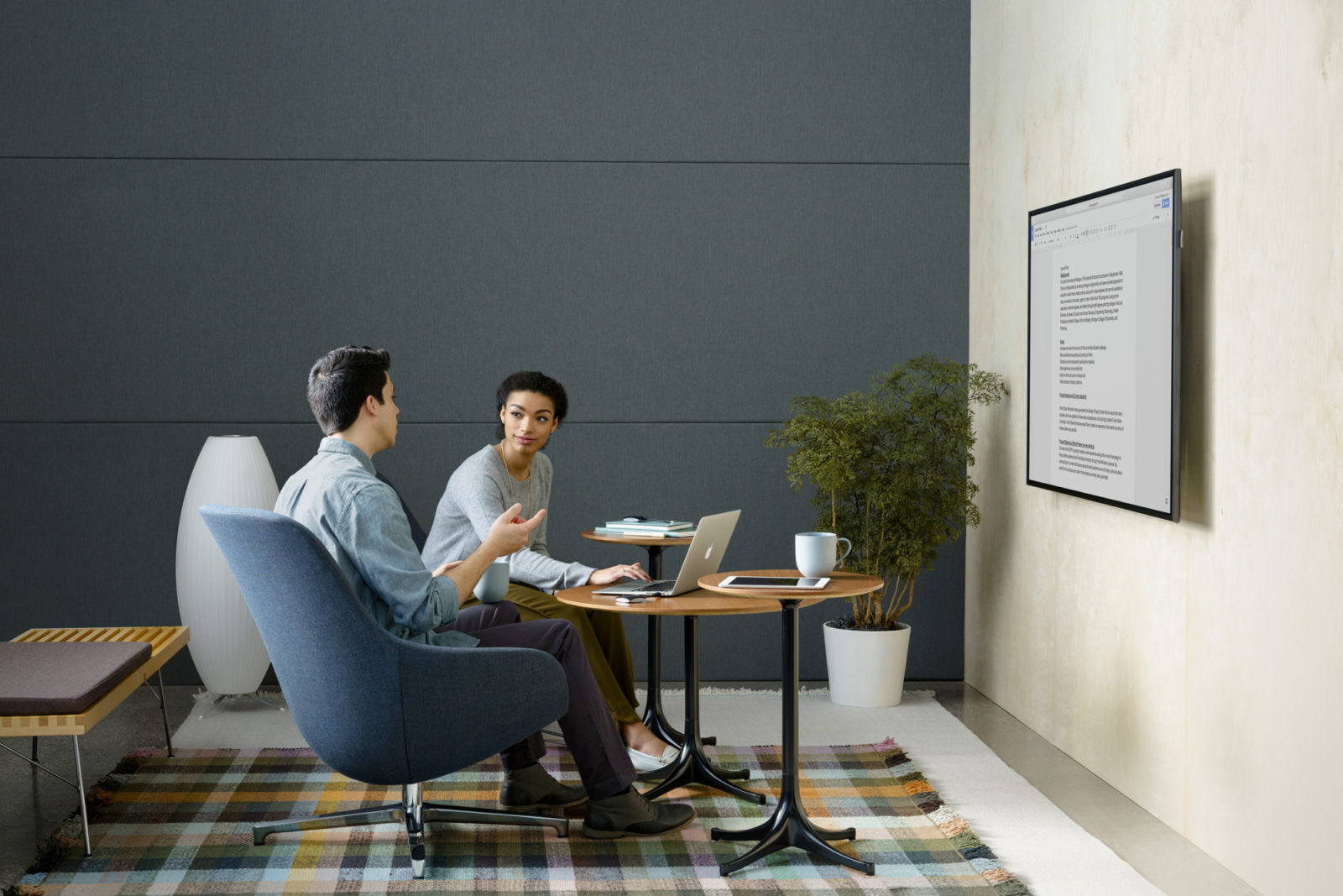 Stock photo of man and woman having a meeting using Herman Miller office furniture