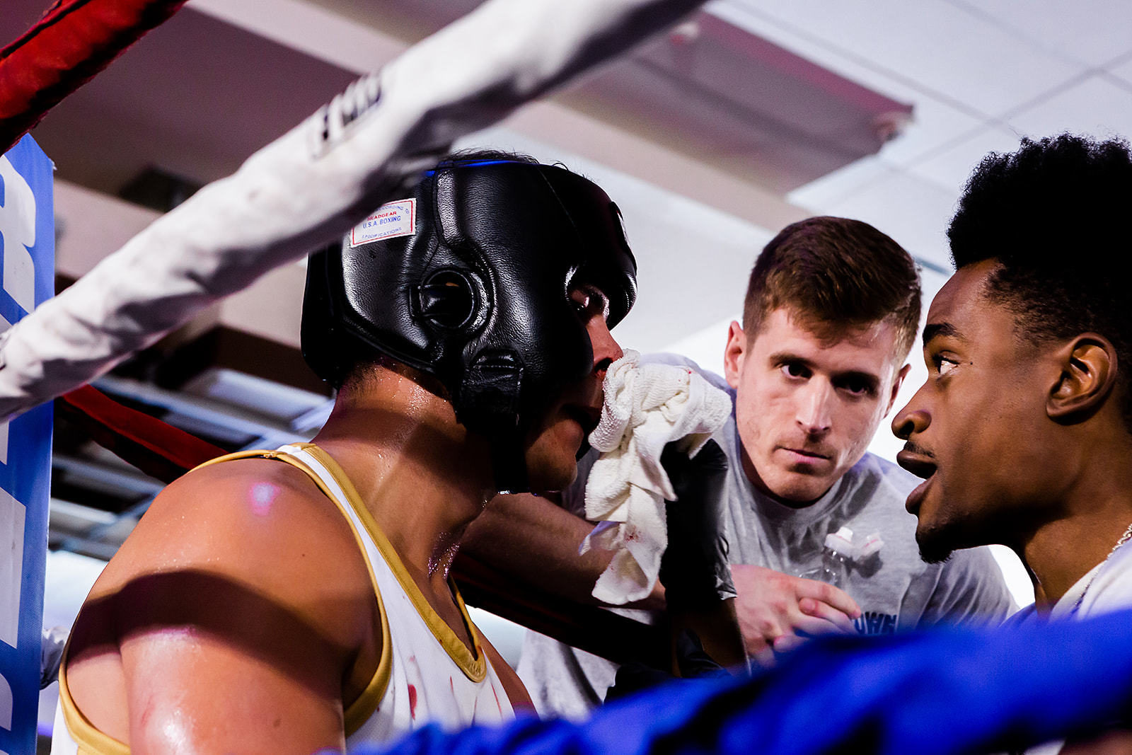 Scott O'Neil having discussion with coaches during charity boxing match