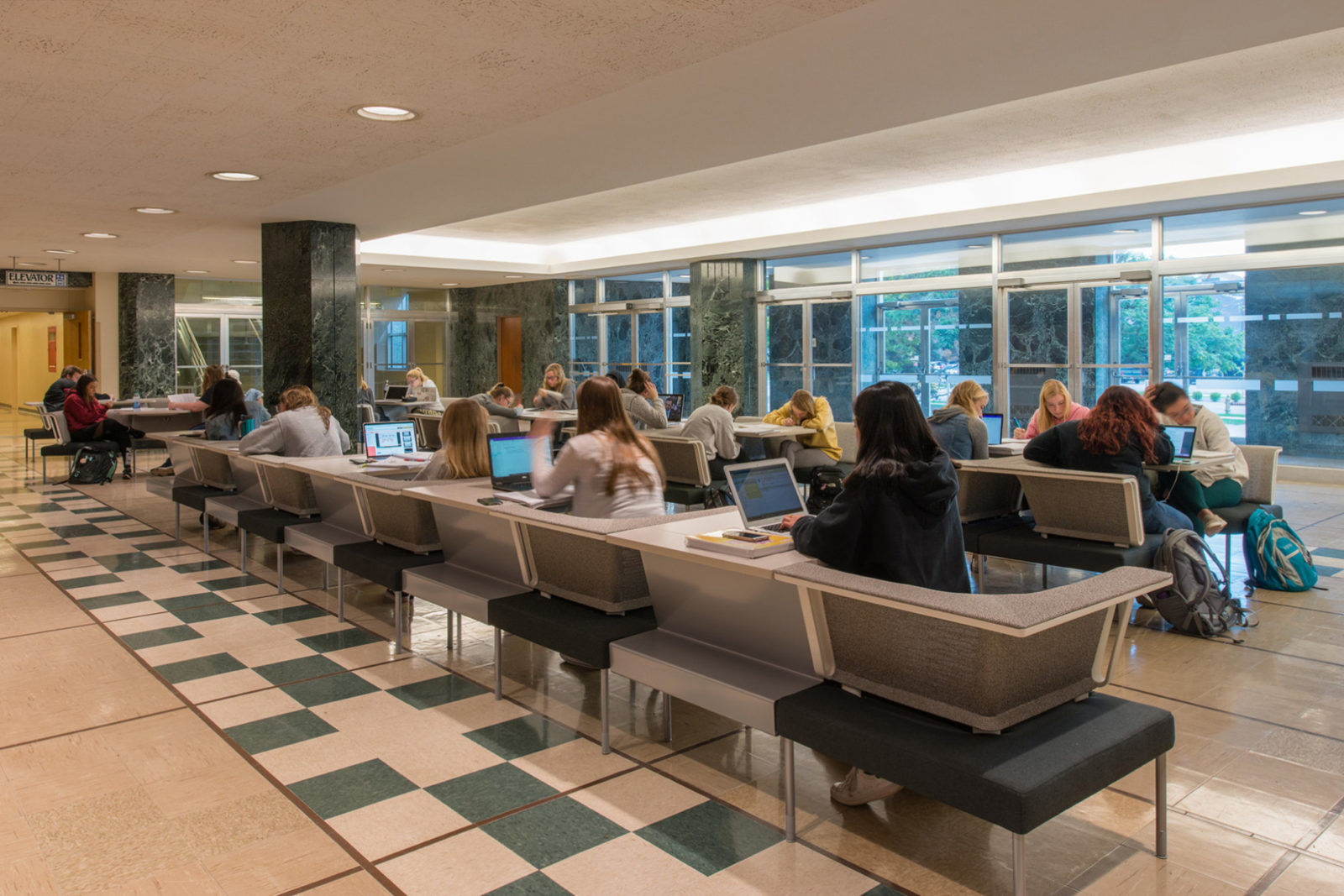 PULilly Project Highlight: back view of students studying at tables