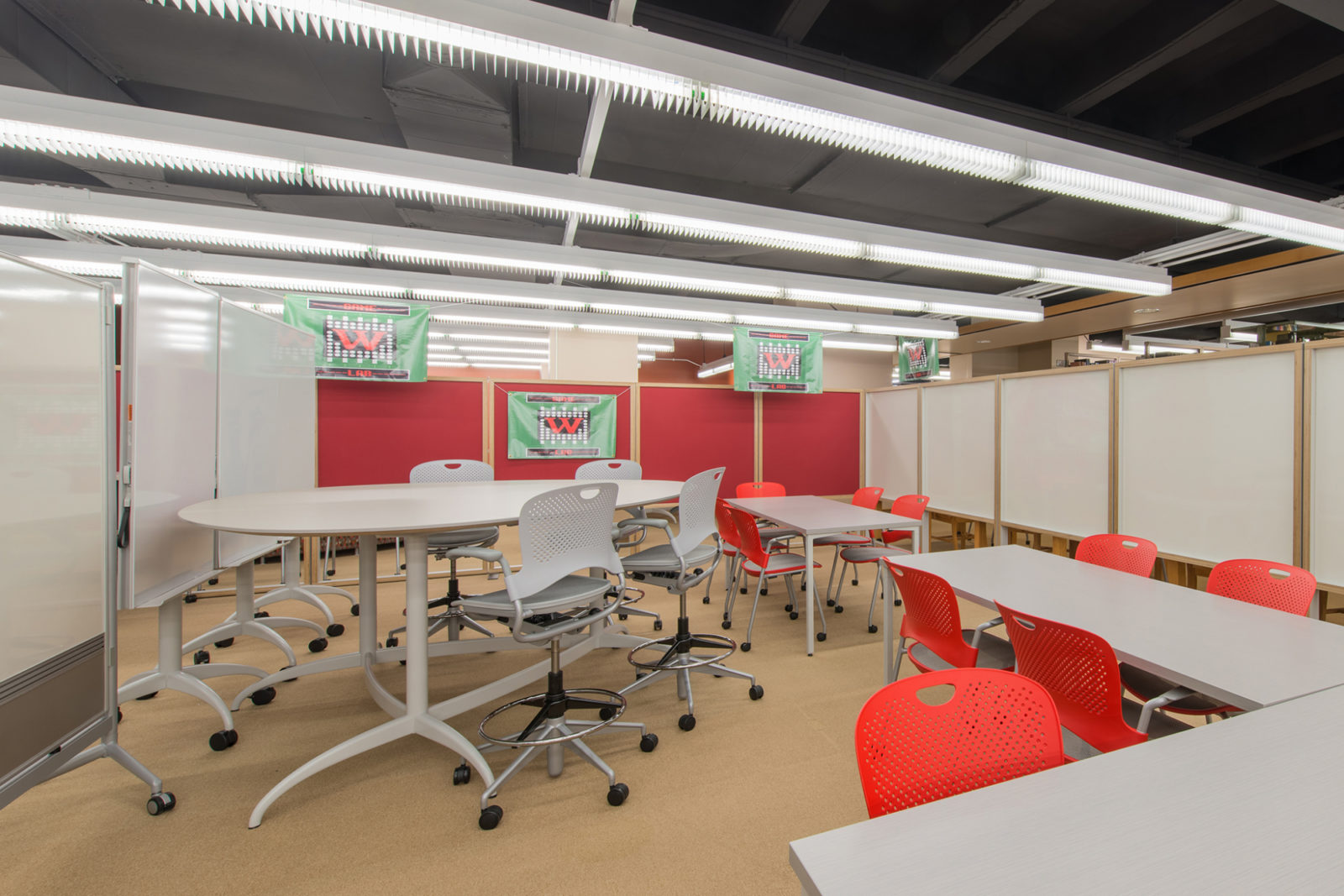 Wabash Project Highlight: tables chairs and whiteboard learning space side view