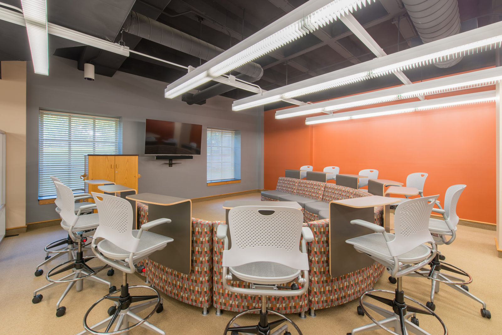 Wabash Project Highlight: Horseshoe discussion seating space back view