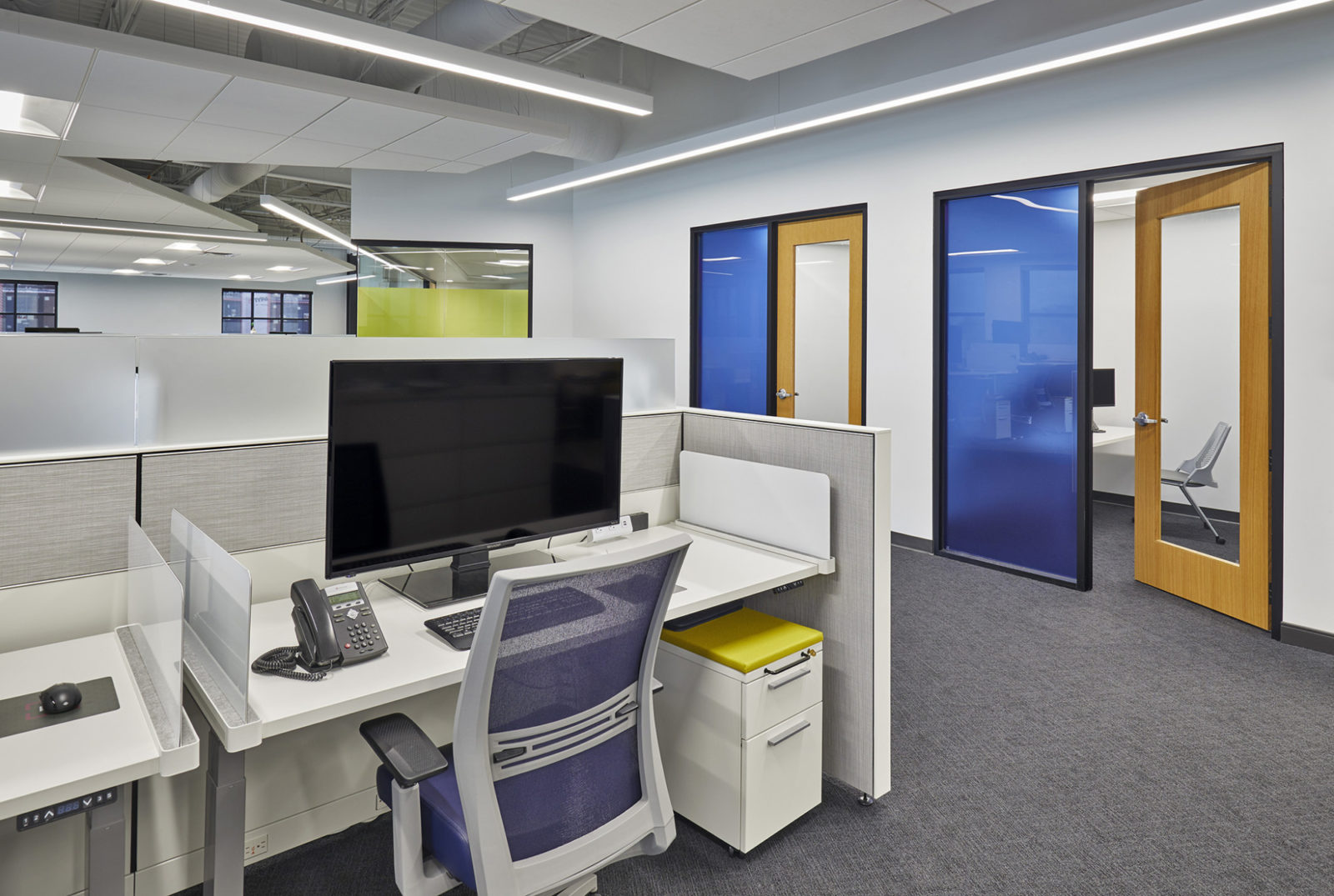 MJ Insurance Project Highlight: desk and office areas