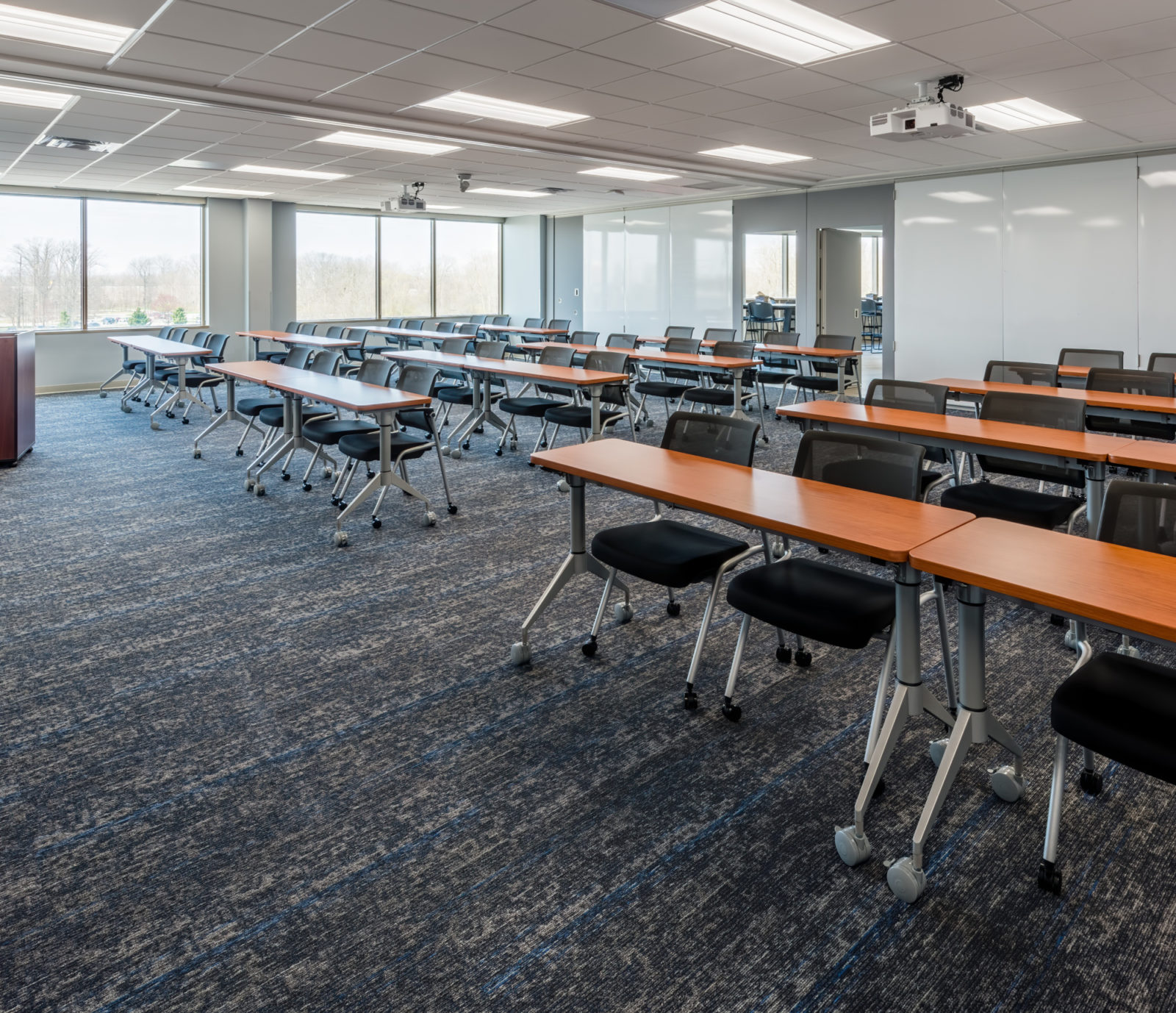 Orbis education room with desks and chairs