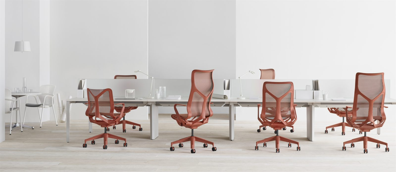 Cosm Chairs in red at desks
