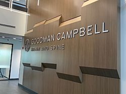 The large Goodman Campbell Brain and Spine center wall in the entryway of the office