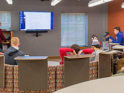 Wabash Project Highlight: horseshoe seating lecture space with students and teacher