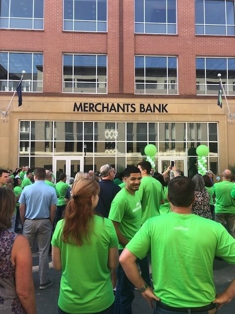 Crowd in front of new Merchants Bank of Indiana headquarters entrance