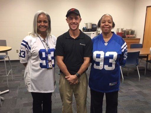 OfficeWorks employee posing with IPS School employees in renovated teachers lounge