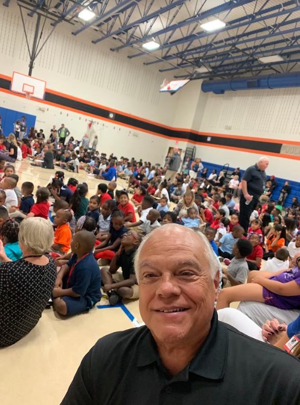 Tom takes selfie at IPS School 51 WISH event