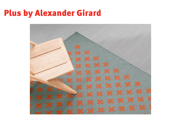 Girard Environmental Enrichment Panels chair with cross patterned rug