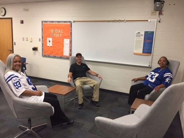 Sitting in new chairs in renovated teachers lounge