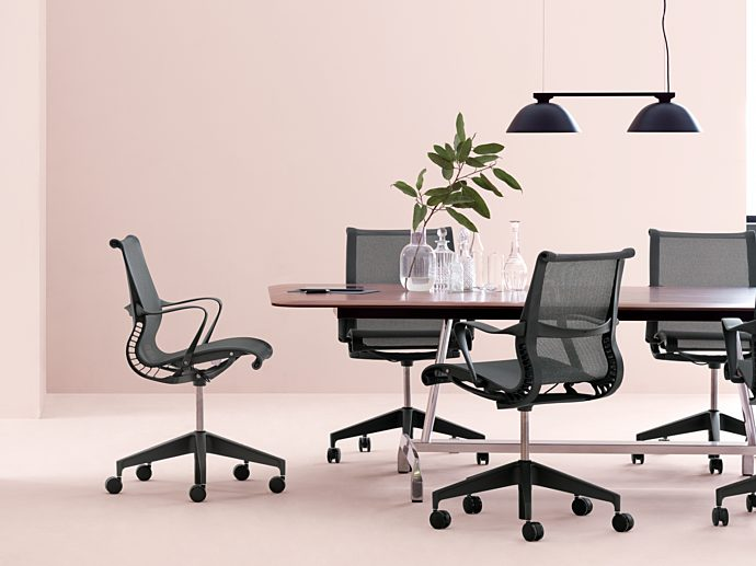 conference room with black chairs and pink walls