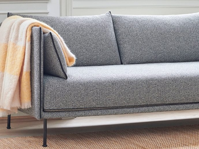 Furniture for Everyday Life grey couch with yellow blanket