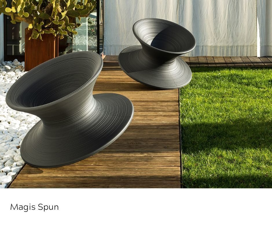 OfficeWorks - Magis Spun Chairs in black outdoors