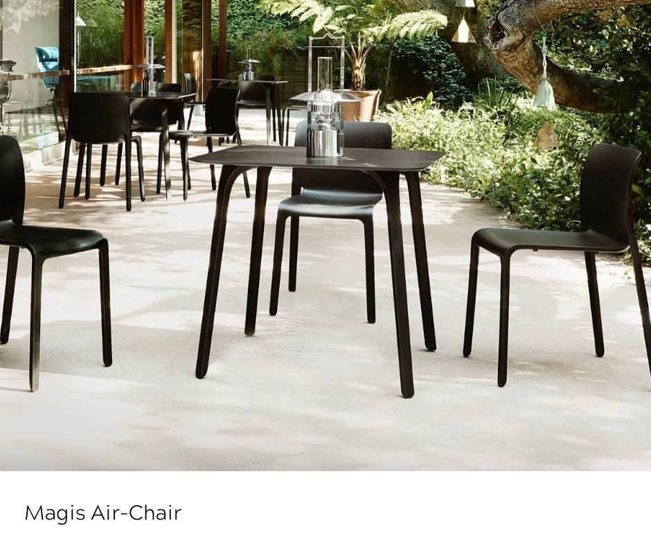 Magis Airchair in black outdoors around a table
