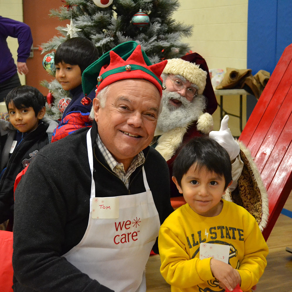 Tom, child and Santa at WeCare Christmas event