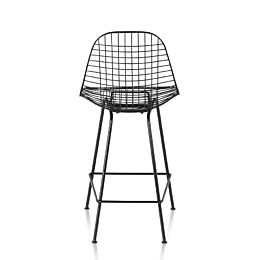 Rear view of a black Eames Wire Stool