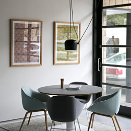 Four naughtone Always Side Chairs—two upholstered blue with wooden legs, two upholstered gray with white steel legs—circled around a Megaped table.