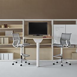 A Canvas Group display wall with storage, a display, and grey Setu stools.