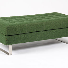 A naughtone Clyde Bench featuring a steel sled base and green upholstery, viewed at an angle