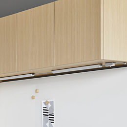 Two Cast LED Lights without valances connected to an on/off switch installed underneath a light wood upper cabinet.