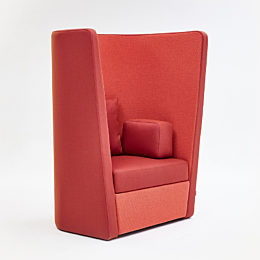 A red naughtone Busby Chair, viewed at an angle.