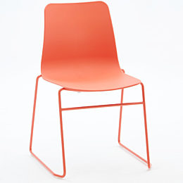 An orange naughtone Polly Side Chair with sled base, viewed at an angle.