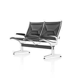 Angled view of black leather Eames Tandem Sling Seating with two seating positions.