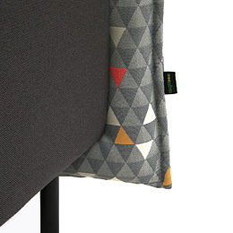 A close-up detail of a Cloud Plain Booth where the gray seat meets the triangle-patterned surround. The naughtone tag is clearly visible.