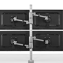 Rear view of four monitors attached to a single Daisyone Monitor Arm post