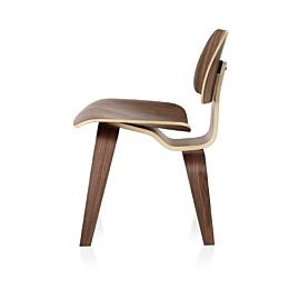 Eames Molded Plywood Chair with a medium finish and wood legs, viewed from the side