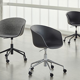 Three, 5-star swivel base About A Chair variations staged off-set from one another.