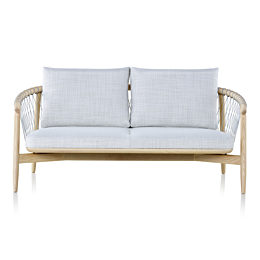 A light-colored Crosshatch Settee featuring gray upholstery and a white ash frame.