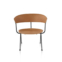 Magis Officina Low Chair in natural leather, viewed from the front