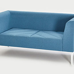 Front angled view of blue Hatch Sofa with a white base