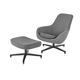 45 degree angle of a grey Saiba lounge chair with a black base paired with a matching Saiba Ottoman