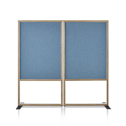 A Canvas Group boundary screen with tackable surfaces in blue fabric.