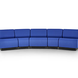 Five blue Chadwick Modular Seating modules arranged to form a gentle curve.